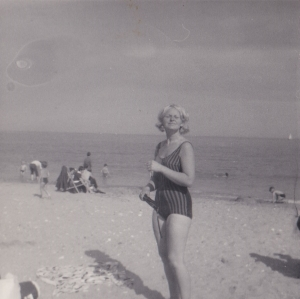 Mum pictured long me. Here, Mum is the same age as I am now - looking efortlessly glam on the beach!
